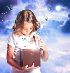 Girl Opening a Box with Blue Butterflies
