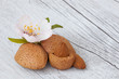 almonds on wooden background white I