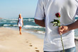 the romantic date concept - man with rose waiting his woman on t