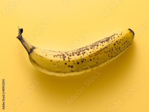 banana on a yellow background, tone on tone