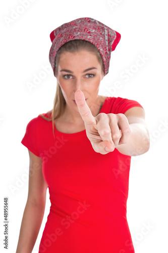 Frau in Rot isoliert zeigt mit dem Finger