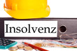 Aktenordner und Bauhelm - Insolvenz