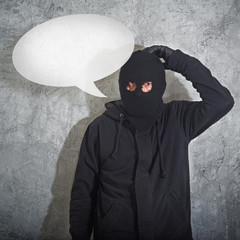 Confused burglar with speech balloon