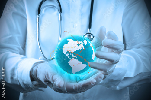 Medical Doctor holding a world gobe in her hands