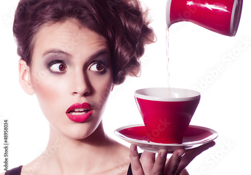 young woman with fashion makeup and tea cup