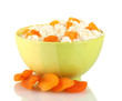 Cottage cheese in color bowl with apricot, isolated on white
