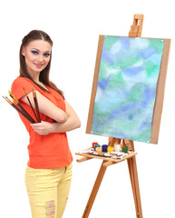 beautiful young woman painter with brushes, isolated on white