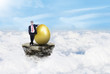 Businessman and gold eggs on clouds