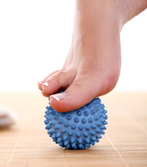 Beautiful foot with massage ball
