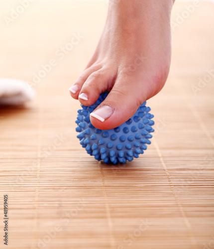 Beautiful foot with massage ball