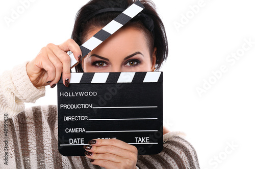 Young happy woman holding a clapboard