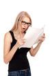 Shocked girl reading womens magazine