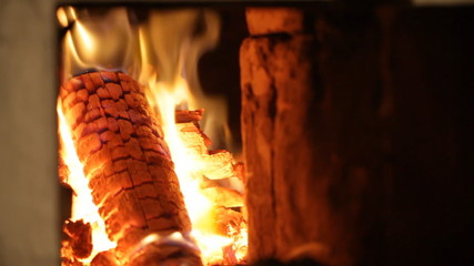 Wood burning in fireplace, zoom