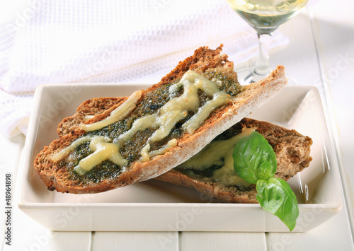 Toasted pesto bread with cheese
