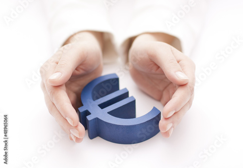 Euro sign protected by hands