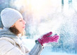 Beautiful Winter Woman Blowing Snow outdoor