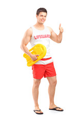 Full length portrait of a happy lifeguard on duty giving a thumb