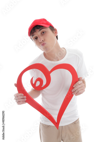 Teenager holding red love heart kiss