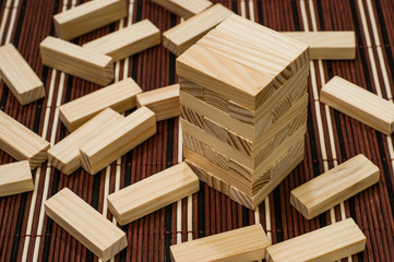 Wooden blocks tower and block spread around