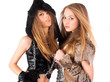 Two girl in barbarian and cat costumes