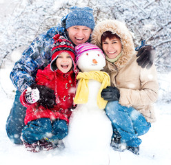 Happy family with snowman