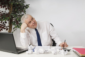 Frustrated Businessman Sitting At Desk