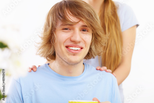 Young happy man drinking tea