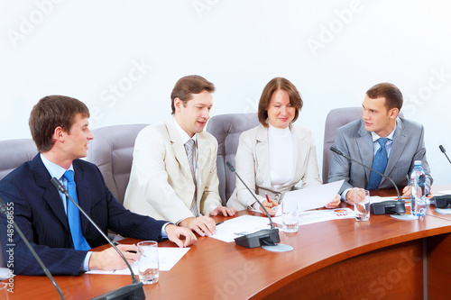 Four businesspeople at meeting