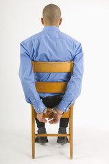 Handcuffed Man Sitting In Chair