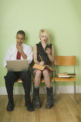 Businessman and Punk Girl Sitting Together
