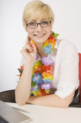 Blond Woman Wearing A Lei At Work
