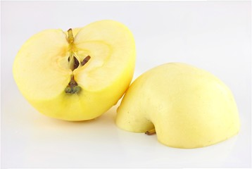 cut two pieces yellow apple isolated on a white background