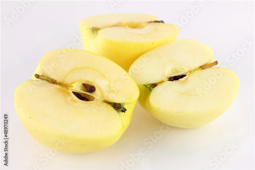cut three pieces yellow apple isolated on a white background