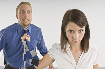 Woman Pulling Man By His Necktie