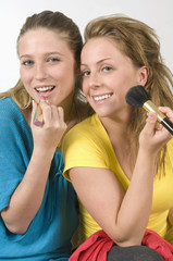 Women Putting On Make-Up