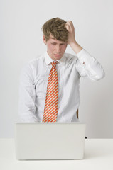 Frustrated Man Working On Laptop
