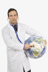 Doctor Using Stethoscope On A Globe