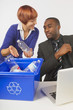 Woman Showing Coworker Recycling Procedures