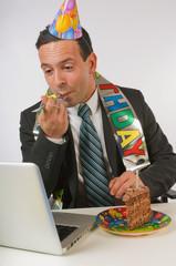 Businessman Eating Birthday Cake