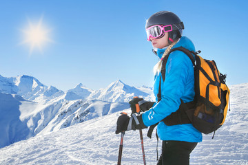 Female skier with beautiful mountain panorama