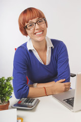 Happy Businesswoman Leaning on Desk