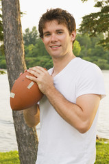 Teenage Boy Holding A Football