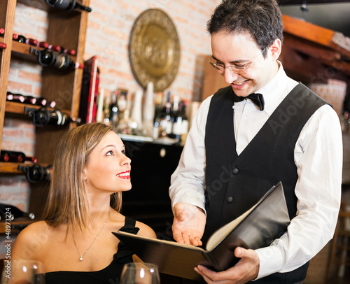 Waiter suggesting food in a restaurant