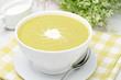 bowl of green pea soup with ginger and cream horizontal