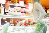 Shopkeeper serving a customer