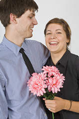 Couple Standing Together With Flowers