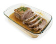 Sliced baked pork  with rosemary, garlic and dill on white