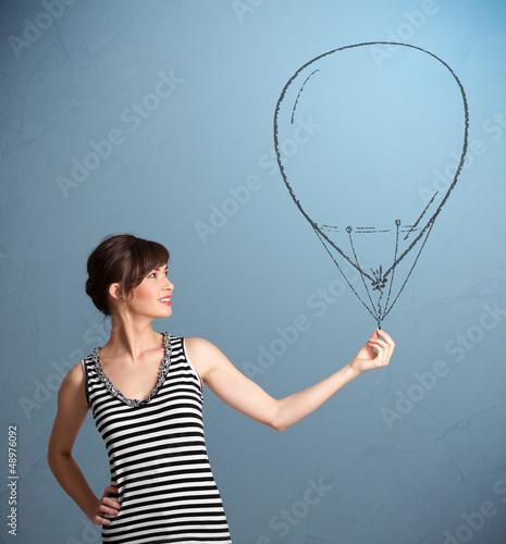 Beautiful woman holding balloon drawing