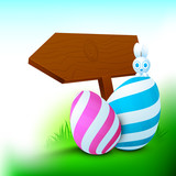 Easter bunny with beautiful painted eggs and wooden sign board f