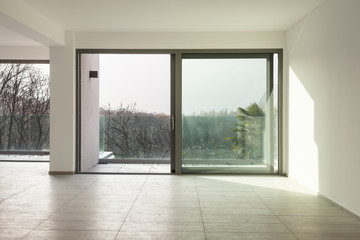 a space in a modern house, empty room with a big window